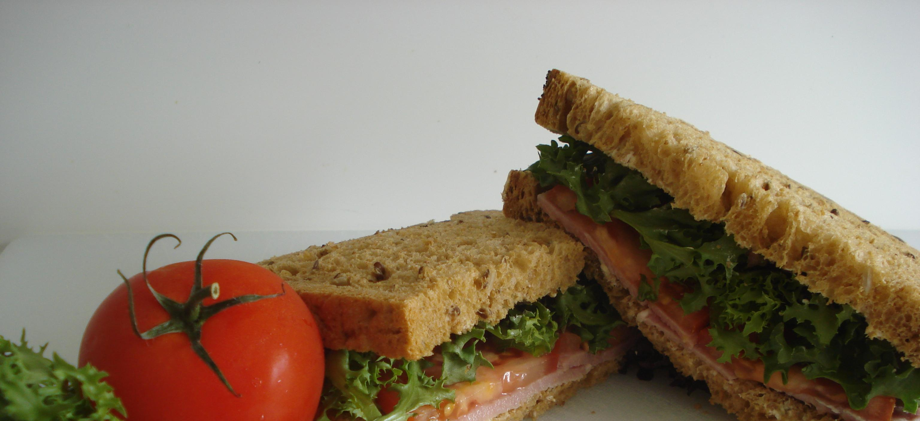 Picture of our sandwich of the week, bacon, lettuce and tomato in multigrain bread